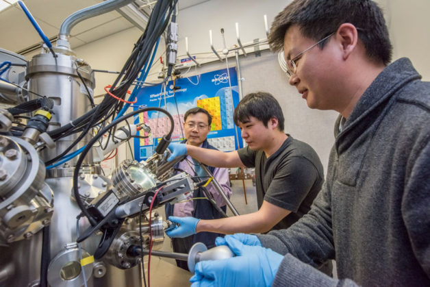 Berkeley Lab scientists Junqiao Wu, Fan Yang, and Changhyun Ko (l-r) are working at the nano-Auger electron spectroscopy instrument at the Molecular Foundry, a DOE Office of Science User Facility. They used the instrument to determine the amount of tungsten in the tungsten-vanadium dioxide (WVO2) nanobeams. (Credit: Marilyn Chung/Berkeley Lab)