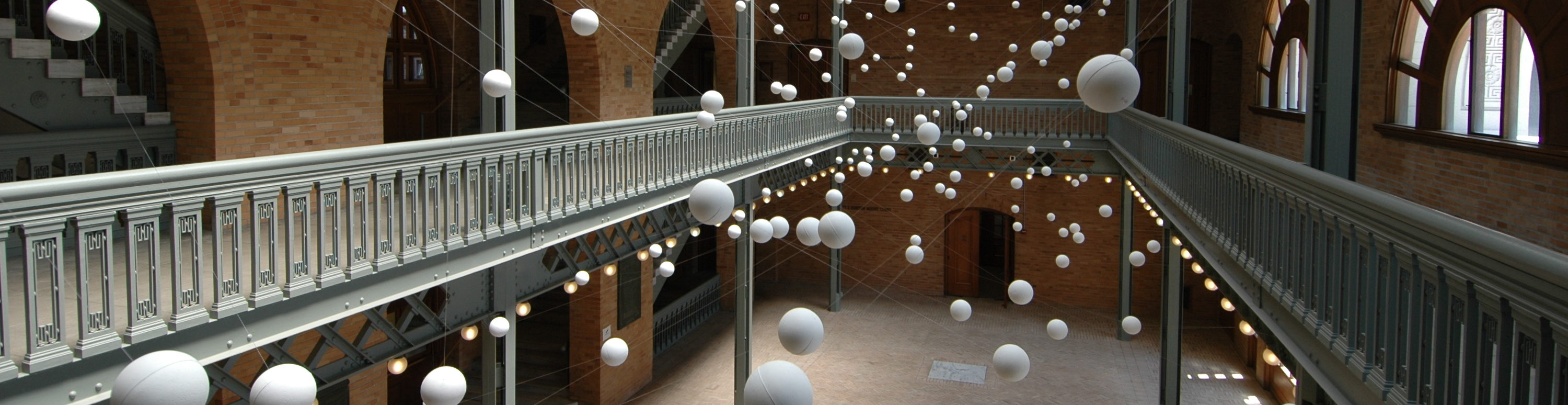 Foam balls suspended in the atrium of Hearst Memorial Mining Building in an art installation by J. Ignacio Diaz de Rabago